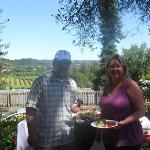 Intimate Wine Tour clients enjoying their gourmet picnic lunch at Raymond Burr Winery in the pic
