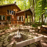 Lincoln: The firepit is surrounded by woods and a peaceful retreat.
