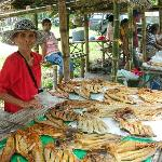 old lady selling yummy dried fish