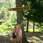 Granddaughters pointing the way to the swimming hole!