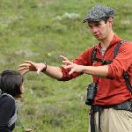 Matt, a Camp Denali naturalist guide, describes a feature during a hike at Camp Denali