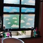 The bathroom window.... Blue sky every morning :)