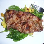 Steak with potatoes and spinach.
