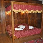 Our absolutely beautiful four-poster wood-ceiling bed.
