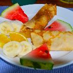 Fruit Filled crepes and fresh fruit