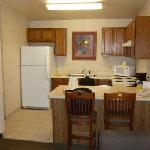 la chambre avec cuisine équipée