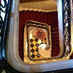 Stairway looking down to a rose bouquet.