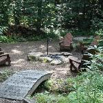Fire pit with horse shoe pit behind. No bugs at the Good Timber!