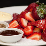 Fresh strawberries, dipping pots