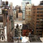 A 'Cheap room' on the 11th floor, view from the window. The Empire State Building is there in th