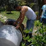 Silvio cleaning out a wine barrel