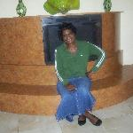 Relaxing and posing for picture by fireplace in hotel.