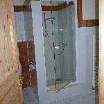 Shower in spacious bathroom