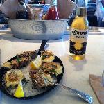 Tasty Rockefeller Oysters with a bottle of Corona