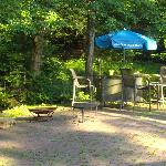Firepit and sitting area in back