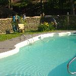 Nice pool with BBQ , sitting area, chairs etc