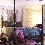 Anne Arundel Mini-Suite - This room is romantically abloom with color and tapestry, crowned by a