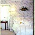 Compass Rose Room - A very special room festooned in roses, eyelet, wicker and a white-iron doub