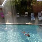 My friend floating in the pool, taken from our 3rd floor room
