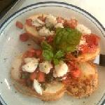Bruschetta with diced marinated tomatoes and jumbo lump crab meat topped with fresh basil