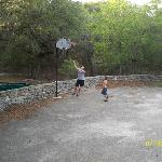 Playing basketball while staying at the lodge.