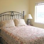 Queen bed in Guest Cottage bedroom