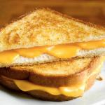 White or wheat warmed on panini grill with cheese