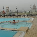 Swimming in the rain in hotel roof pool.