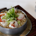 Myanmar's Tiger Prawn and Rice cooked with double boiled Lobster Consomme in Claypot