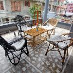 Balcony arranged with cane furnitures to seat and relax