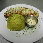 amazing stuffed chicken with sausage motz cheese and a magical sauce like no other on top