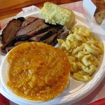 brisket platter with mac n cheese and sweet potato souffle.