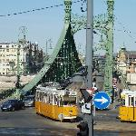 Tram cars cross the bridge from the hotel