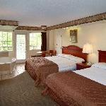 Spacious rooms with two queen beds and balconies.