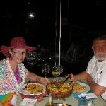 Author & spouse with seafood paella-style dish