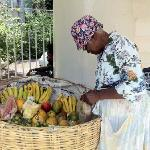 woman selling fruit at bottom of spiral staircase daily