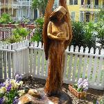 Angel carved in a tree stump after the last hurricane.  The neighborhood and property are all we