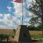 The stone marker and flag pole