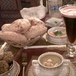 Warm pitas, lentil soup, falafel and hibiscus water