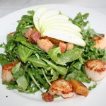 Scallops and Bacon over arugula salad