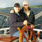 Jerry & Cecilia at the helm of the Manitou