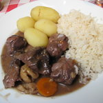 """Wild boar"" stew with potatoes and rice."