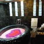 Rose bath prepared in room