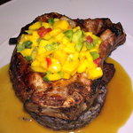 "Chuleton de Chancho - grilled pork chop, black bean ""tacu-tacu"", aji honey mustard, plantains, a"