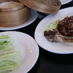 Peking duck wraps served with hoisin sauce and refreshing vegetables.