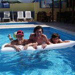 Happy family in the cleanest pool