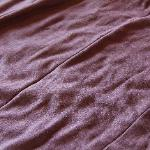Gross, tattered bed spread