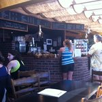 Muddy Waters bar with plethora of baked goodies and a large menu of coffees and other drinks