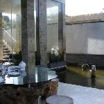 The outdoor dining room, fish pound and indoor living room