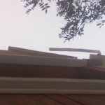 what appears to be soffit swinging in the wind